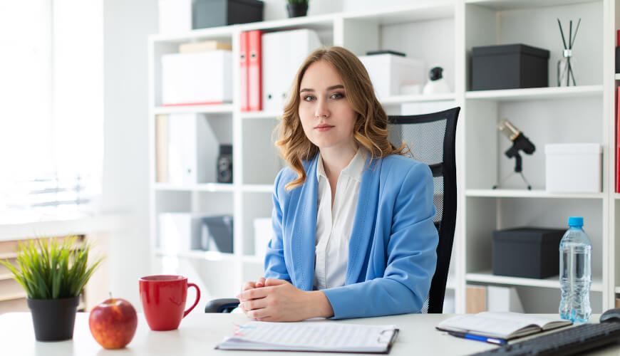 Picture of woman sitting at a desk