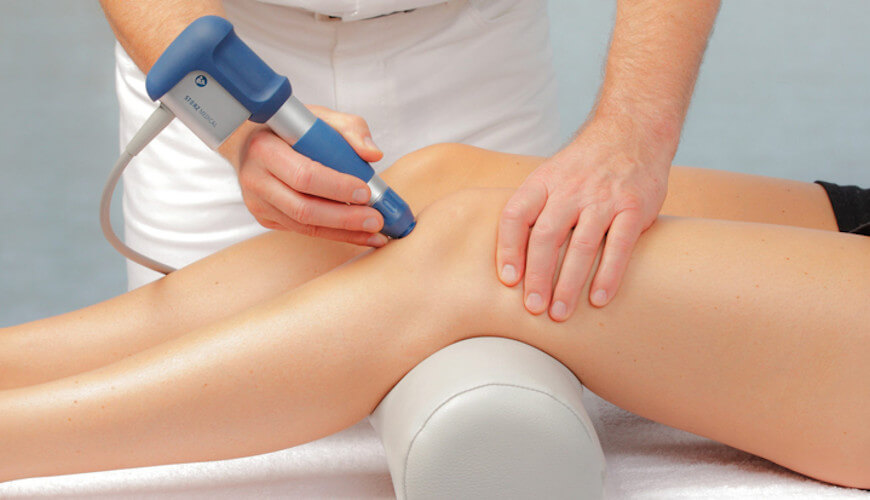 Shockwave Therapy Device on knee