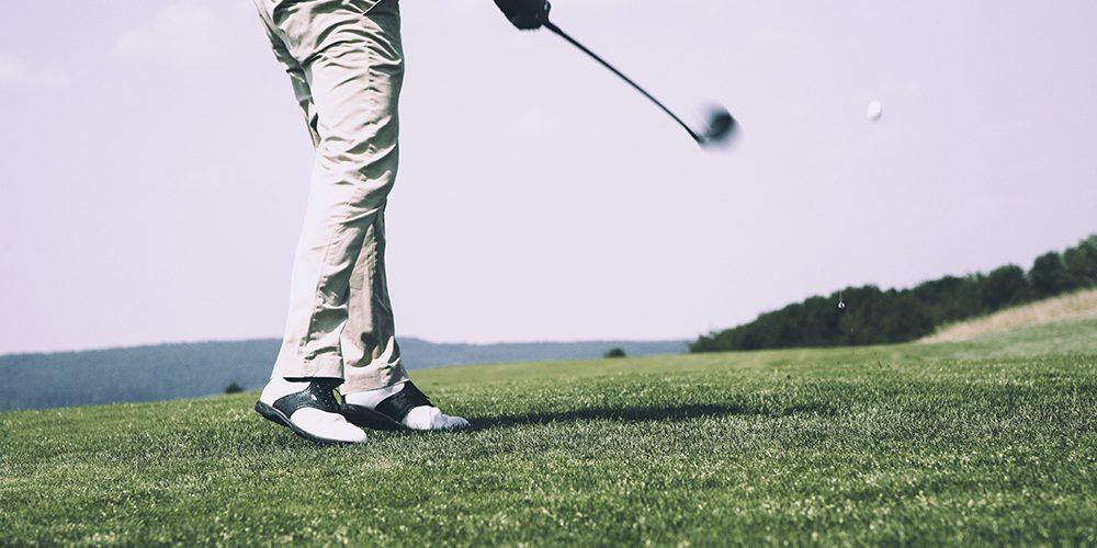 Golfer hitting the ball