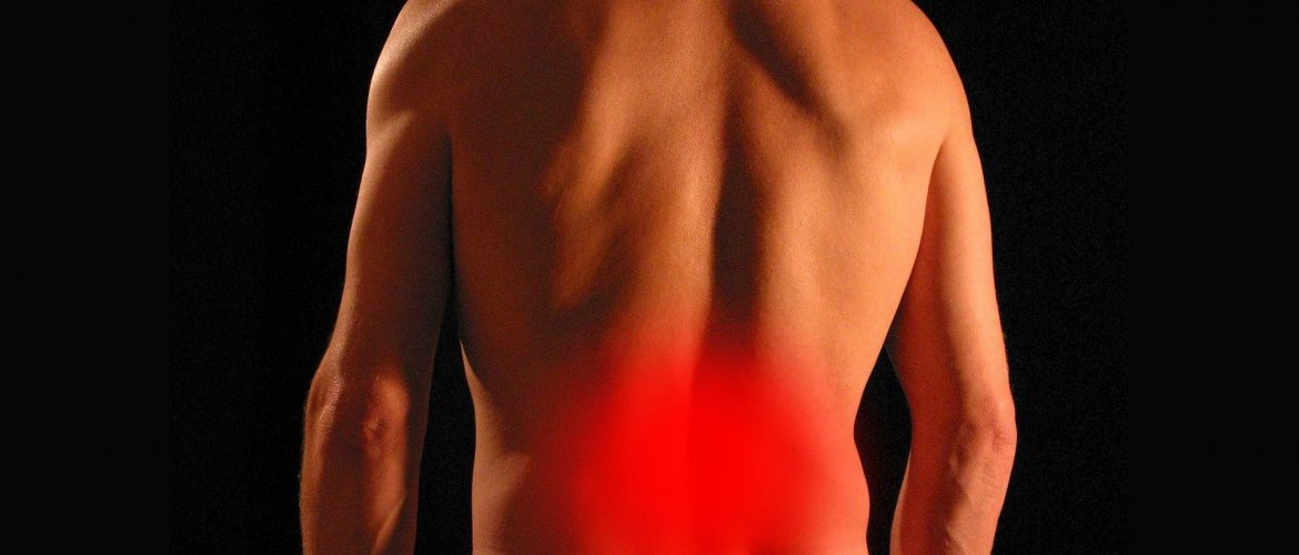 Man's back with a red circle to show back pain